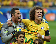 David Luiz (right) and Julio Cesar of Brazil hold up the shirt of injured team mate, Neymar Jr.  during the 2014 FIFA World Cup match at Mineirão, Belo Horizonte<br /> Picture by Stefano Gnech/Focus Images Ltd +39 333 1641678<br /> 08/07/2014