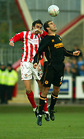 Photo. Chris Ratcliffe<br />Cheltenham v Hull. FA Cup Preliminary Round 08/10/2003<br />ben burgess of cheltenham and michael duff of hull challenge.