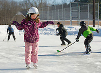 Gabriella Von George practices her figure skating moves during Friday afternoon's skating party at Memorial Park with Laconia Parks and Recreation.  (Karen Bobotas/for the Laconia Daily Sun)