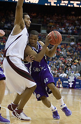 Holy Cross Crusaders guard Torey Thomas (1) drives into Southern Illinois Salukis forward Randal Falker (14).  The #4 seed Southern Illinois Salukis defeated the #13 seed Holy Cross Crusaders 61-51  in the first round of the Men's NCAA Tournament in Columbus, OH on March 16, 2007.