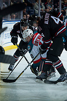 KELOWNA, CANADA - FEBRUARY 14: Ted Brennan #10 of the Kelowna Rockets is checked at the boards by Alexander Alexeyev #4 of the Red Deer Rebels  on February 14, 2018 at Prospera Place in Kelowna, British Columbia, Canada.  (Photo by Marissa Baecker/Shoot the Breeze)  *** Local Caption ***