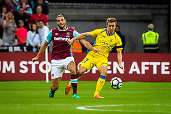 Andy Carroll of West Ham and Gaber Dobrovoljc of NK Domzale during 2nd Leg football match between West Ham United FC and NK Domzale in 3rd Qualifying Round of UEFA Europa league 2016/17 Qualifications, on August 4, 2016 in London, England.  Photo by Ziga Zupan / Sportida