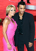 Latin music stars Melina Leon (L) and Jon Secada (R) pose for pictures as they arrive at the 2002 Latin Billboard Awards show taping in Miami Beach, Florida May 9, 2002. The event showcases the music industry's hotest latin music stars, will air on the Telemundo network, May 12, 2002. PHOTO BY:COLIN BRALEY