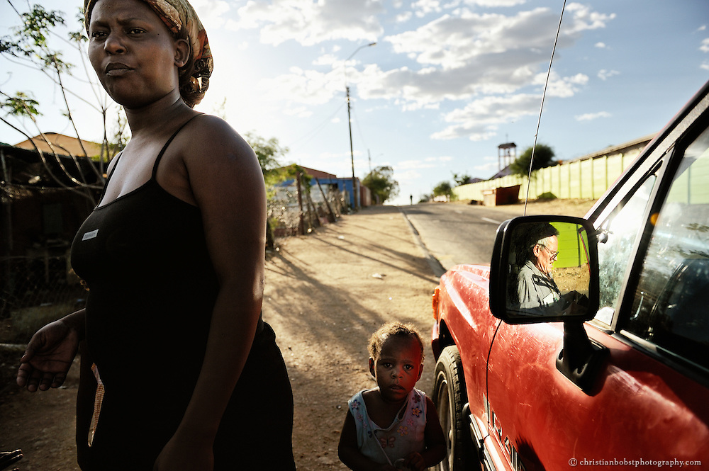 (2008) Whenever possible, Hermann ventured out into the townships to assist with problems or to get a sense of the conditions in which those he cares for were living. The priest talked to women and children on the street about the dangers of AIDS and other STDs. He encouraged them to get tested for AIDS and passed out condoms, even though the Catholic Church forbids it.