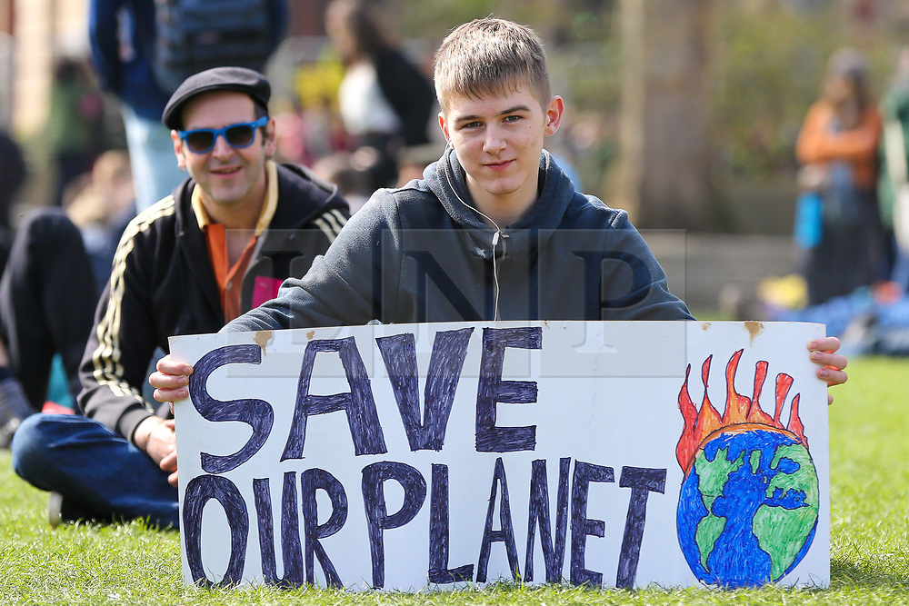 "© Licensed to London News Pictures. 15/04/2019. London, UK. A young environmental activist with a ""Save our Planet"" demonstrates in Parliament Square to demand decisive action from the UK Government. The protest is organised by Extinction Rebellion. Photo credit: Dinendra Haria/LNP"