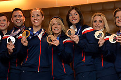 Pictured are some of Team GB's medal winners together back in Britain. 3rd from left is gold medalist Lizzy Yarnold.<br /> Team GB Return from the Sochi 2014 Olympic Winter Games to Heathrow Airport, London, UK.<br /> Monday, 24th February 2014. Picture by Ben Stevens / i-Images