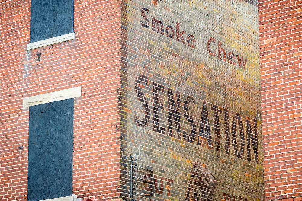 Old cigarette advertisement painted on the side of a brick  building in Cambridge, Maryland