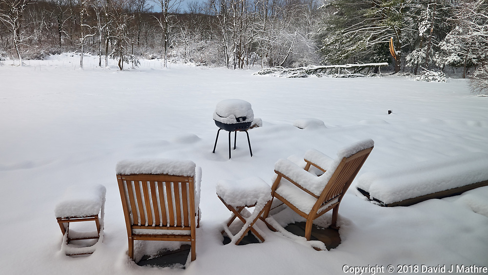 Snow covered patio chairs and grill. Image taken with a Leica CL camera and 18 mm f/2.8 lens (ISO 100, 18 mm, f/3.5, 1/400 sec).