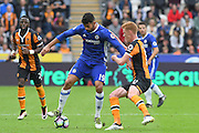 Chelsea forward Diego Costa (19) under attack from Hull City midfielder Sam Clucas (11) during the Premier League match between Hull City and Chelsea at the KCOM Stadium, Kingston upon Hull, England on 1 October 2016. Photo by Ian Lyall.