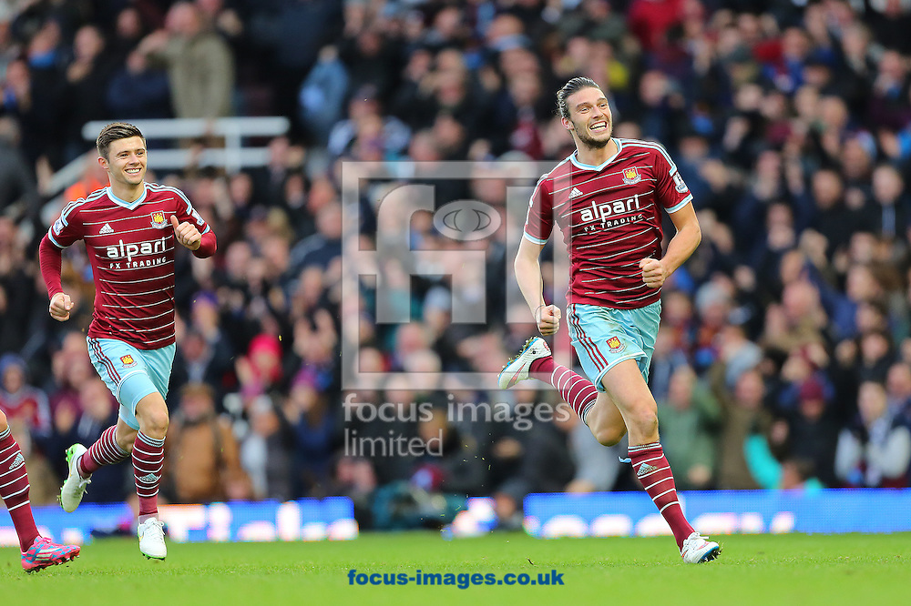 Andy Carroll of West Ham United (right) celebrates after putting his side 2-1 ahead against Swansea City during the Barclays Premier League match at the Boleyn Ground, London<br /> Picture by Richard Calver/Focus Images Ltd +447792 981244<br /> 07/12/2014