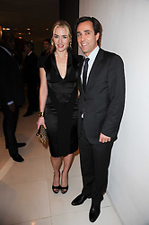 KATE WINSLET and Thierry Cheval at a party to celebrate Lancome's 10th anniversary of sponsorship of the BAFTA's in association with Harper's Bazaar magazine held at St.Martin's Lane Hotel, London on 19th February 2010.