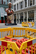 As part of 'Art in the City' in the City of London, the artwork entitled Temple (2008) by Damien Hirst occupies a space in Lime Street near a coil of plastic pipe collars, a visual pun about the resemblance of intestines in the heart of the capital's financial district, the City of London, the capital's financial district (aka The Square Mile), on 26th March, 2018, in London, England.