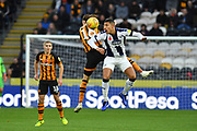 West Bromwich Albion midfielder Jake Livermore (8) and Hull City midfielder Jackson Irvine (16) during the EFL Sky Bet Championship match between Hull City and West Bromwich Albion at the KCOM Stadium, Kingston upon Hull, England on 3 November 2018.