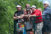 Ellie Spieth, Jordan's sister, watches Jordan putt on the 17th green with friends and family during the final round of the AT&T Byron Nelson in Las Colinas, Texas on May 31, 2015. (Cooper Neill for The New York Times)