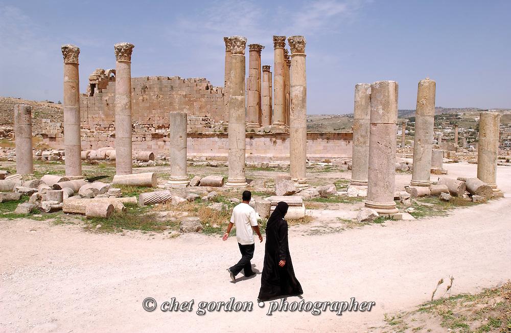 Islamic couple tour the ancient Roman city of Jerash on the outskirts of Amman, Jordan on Thursday, April 20, 2006.