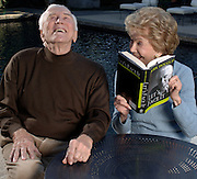 12-6-06-Beverly Hills-Kirk Douglas and his wife Anne share a laugh while pretending to read his recent book at his Beverly Hills home. photo by John McCoy/staff LA Daily News