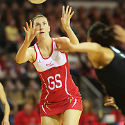 Rachel Dunn, England, receives the ball during the New Zealand V England, New World International Netball Series, at the ILT Velodrome, Invercargill, New Zealand. 6th October 2011. Photo Tim Clayton...
