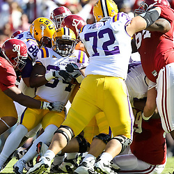 November 6, 2010; Baton Rouge, LA, USA;  LSU Tigers running back Stevan Ridley (34) runs into the pile as Alabama Crimson Tide linebacker Dont'a Hightower (30) makes a tackle during the first half at Tiger Stadium.  Mandatory Credit: Derick E. Hingle