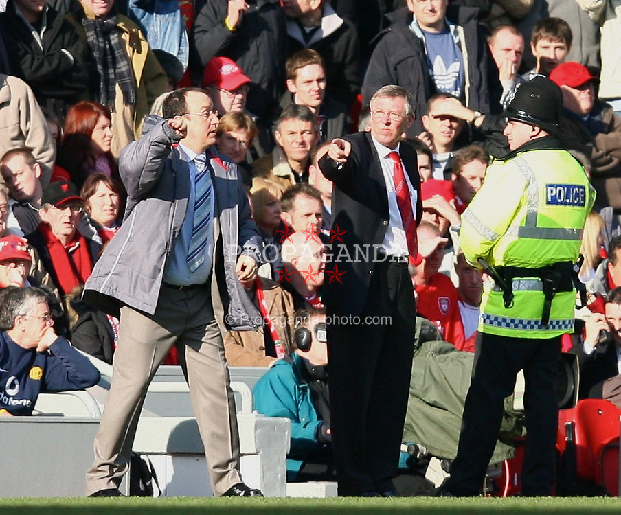 LIVERPOOL, ENGLAND - SATURDAY, FEBRUARY 18th, 2006: Liverpool's manager Rafael Benitez organises his side as Manchester United's manager Alex Ferguson loses his temper during the FA Cup 5th Round match at Anfield. (Pic by David Rawcliffe/Propaganda)