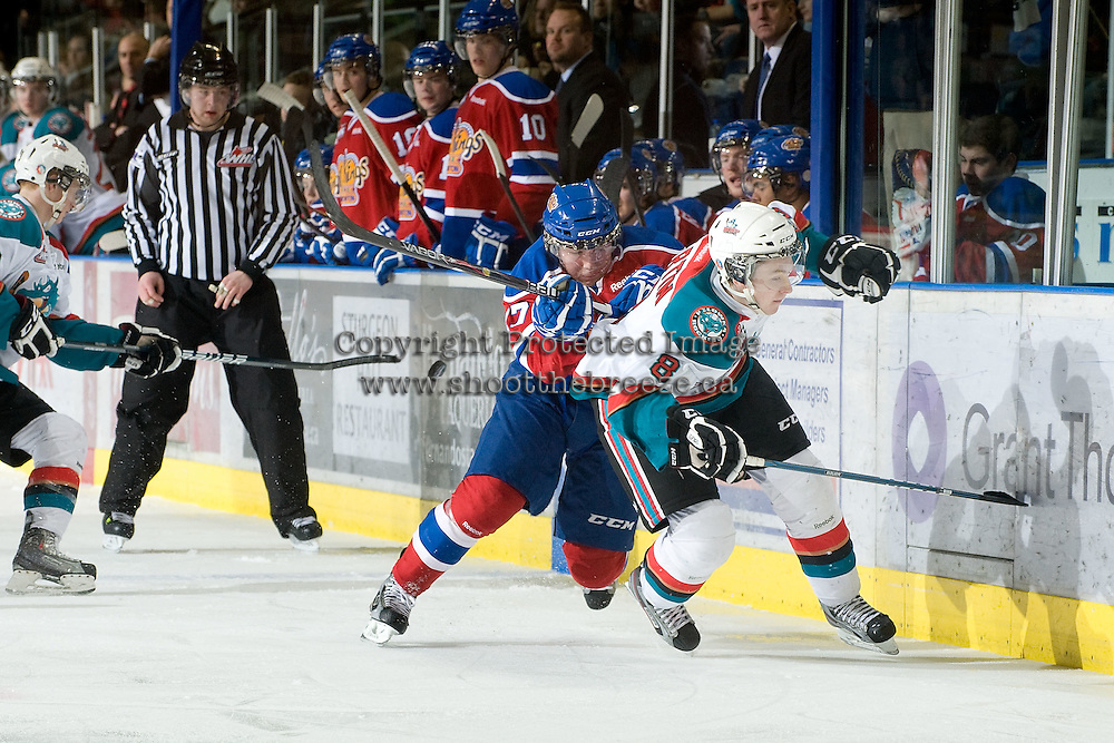 KELOWNA, CANADA - FEBRUARY 15: Curtis Lazar #27 of the Edmonton OIl Kings checks Colten Martin #8 of the Kelowna Rockets at the Kelowna Rockets on February 15, 2012 at Prospera Place in Kelowna, British Columbia, Canada (Photo by Marissa Baecker/Getty Images) *** Local Caption *** Curtis Lazar;Colten Martin;