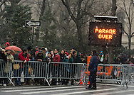 """March 16, 2013 - New York, NY, U.S. - A sign says """"PARADE OVER"""" at the end of the parade route of the 252nd annual NYC St. Patrick's Day Parade, by the Metropolitan Museum of Art. Thousands of marchers show their Irish pride, as they march up Fifth Avenue, and over a million people, often in green and orange, watch and celebrate. The snow that begaan to fall in Manhattan after the parade started didn't stop the celebrations."""