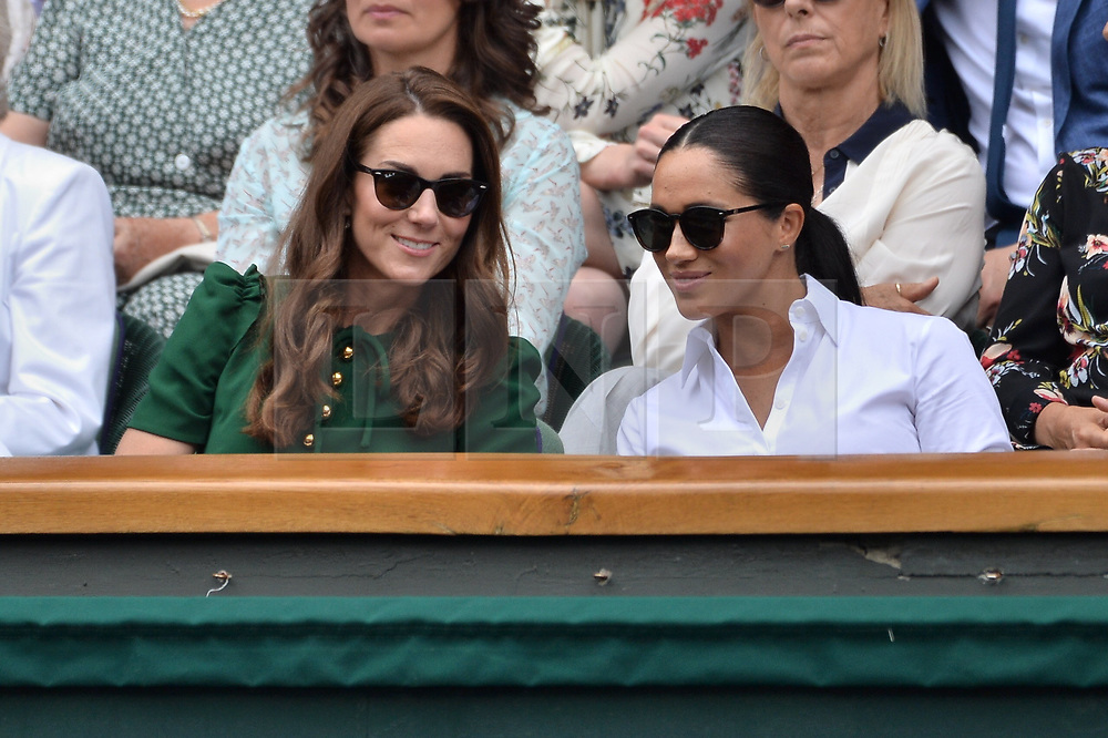 © Licensed to London News Pictures. 13/07/2019. London, UK. HRH The Duchess of Cambridge, HRH The Duchess of Sussex and Pippa Matthews watch the ladies singles finals on centre court tennis on Day 12 of the Wimbledon Tennis Championships 2019 held at the All England Lawn Tennis and Croquet Club. Photo credit: Ray Tang/LNP