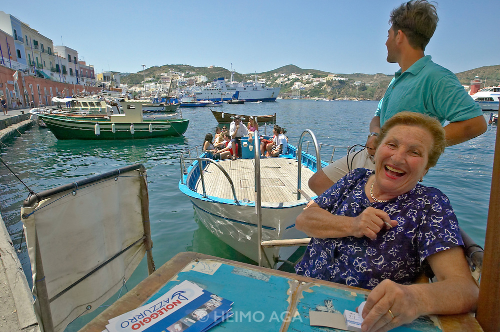 Boss of a tourist boat charter at the harbour of Ponza.