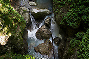 A small waterfall and mountains waters in Tolmin Gorge (Tolminska Korita), on 20th June 2018, in Tolmin Gorge , Slovenia.