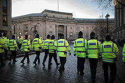 "© Licensed to London News Pictures . 26/11/2016 . Bolton , UK . Police move to separate anti-fascist protesters from the anti-mosque demonstrators ,  behind Bolton Town Hall . Approximately 100 people attend a demonstration against the construction of mosques in Bolton , under the banner "" No More Mosques "" , organised by a coalition of far-right organisations and approximately 150 anti fascists opposing the demonstration , in Victoria Square in Bolton Town Centre . Photo credit : Joel Goodman/LNP"