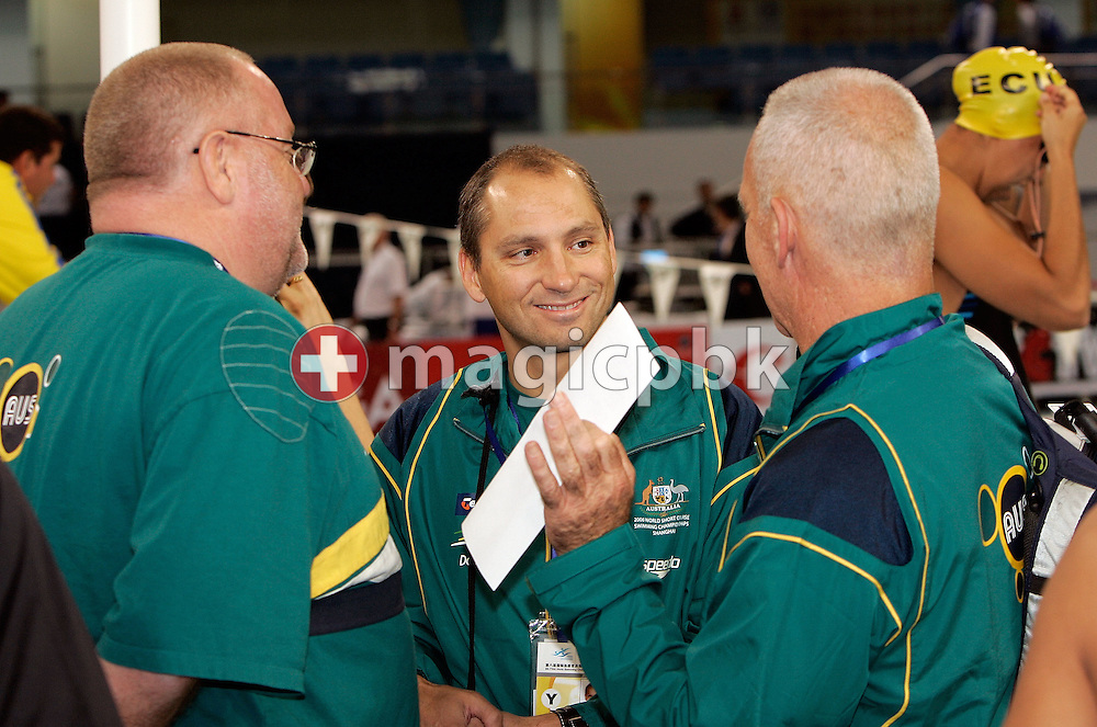 (L-R) National Head Coach of Australia Alan Thompson talks to his coaches Stephan WIDMER and Greg SALTER during warm-up before the morning session during day two of the 8th FINA World Swimming Championships (25m) held at Qi Zhong Stadium April 6th, 2006 in Shanghai, China. (Photo by Patrick B. Kraemer / MAGICPBK)