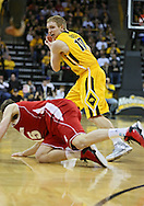 January 19 2013: Iowa Hawkeyes guard Mike Gesell (10) keeps the ball away from Wisconsin Badgers forward Sam Dekker (15) during the first half of the NCAA basketball game between the Wisconsin Badgers and the Iowa Hawkeyes at Carver-Hawkeye Arena in Iowa City, Iowa on Sautrday January 19 2013. Iowa defeated Wisconsin 70-66.
