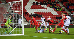 LIVERPOOL, ENGLAND - Tuesday, December 9, 2014: Liverpool's Daniel Cleary scores the second goal against FC Basel during the UEFA Youth League Group B match at Langtree Park. (Pic by David Rawcliffe/Propaganda)