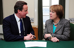 Leader of the Conservative Party David Cameron with Caroline Spelman Member of Parliament for Meriden in his office in Norman Shaw South, January 5, 2010. Photo By Andrew Parsons / i-Images.