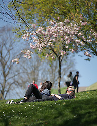 © Licensed to London News Pictures. 21/04/2015. Bristol, Avon, UK. A couple relaxing in the park on Brandon Hill in Bristol today, 21st April 2015. The south west of England is set for more warm temperatures and plenty of sunshine today. Photo credit : Rob Arnold/LNP