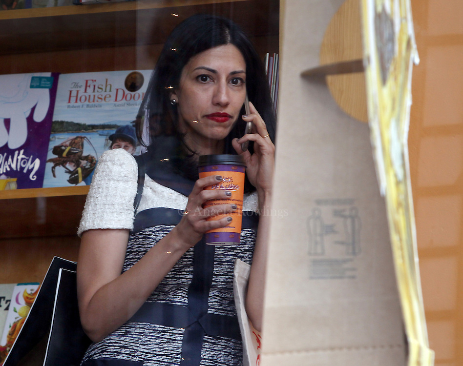 (Exeter, NH - 5/22/15) Huma Abedin is seen making a phone call from inside a book store during a campaign stop for former Secretary of State and presidential candidate Hillary Clinton in Exeter, Friday, May 22, 2015. Staff photo by Angela Rowlings.
