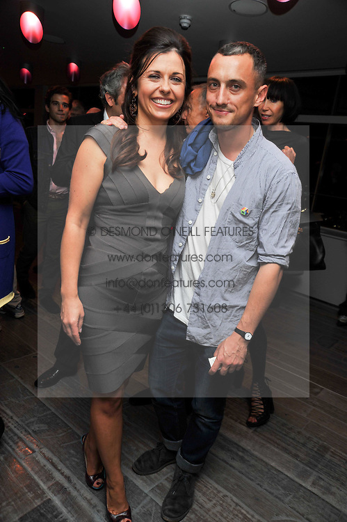 ALISON JACQUES and RICHARD NICHOLL at a dinner in honour of artist Ryan McGinley hosted by Alison Jacques to mark the occasion of his UK debut show 'Moonmilk' held at Paramount, Level 31, Centre Point, 103 New Oxford Street, London WC1 on 10th September 2009.