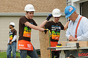 James Pickering and Eric Dziybyk, both 16 (center left and right respectively), take a few safety pointers on using a power saw while helping build homes with Habitat for Humanity in West Chicago, Illinois on Saturday, May 21st, 2011 during Nicor's 15th Volunteer Day. The company's annual event includes volunteering at events like outdoor clean ups at local social service agencies, food sorting at area pantries and energy-saving improvements at the homes of senior citizens. For additional information, visit nicor.com or contact Richard Caragol at 630-388-2686.