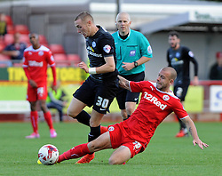 Peterborough United's Marcus Maddison tussles for the ball with Crawley's Keith Keane - photo mandatory by-line David Purday JMP- Tel: Mobile 07966 386802 - 11/10/14 - Crawley Town v Peterbourgh United - SPORT - FOOTBALL - Sky Bet Leauge 1  - London - Checkatrade.com Stadium