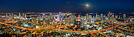 Miami skyline aerial panorama with full moon at twilight viewed looking east. This version is watermarked, contact us to license and clean version.