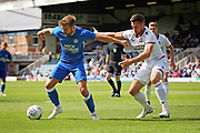 Peterborough United forward Matthew Godden (9) shields the ball during the Pre-Season Friendly match between Peterborough United and Bolton Wanderers at London Road, Peterborough, England on 28 July 2018. Picture by Nigel Cole.