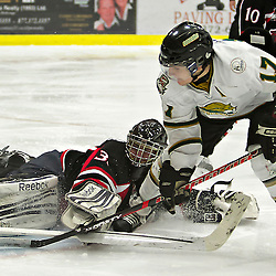 COBOURG, ON - Dec 8 : Ontario Junior Hockey League Game Action between Cobourg Cougar's Hockey Club & Pickering Panther's Hockey Club, during second period game action, Pickering Panther's Hockey Club #33 makes the save from Justin Danforth #17 of the Cobourg Cougars.(Photo by Dave Powers / OJHL Images)