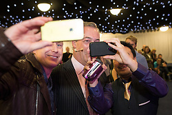 """© Licensed to London News Pictures . 30/11/2015 . Leeds , UK . People take selfies with NIGEL FARAGE before he addresses a """" Say No to the EU """" event at the Leeds United's ground at Elland Road . Photo credit: Joel Goodman/LNP"""