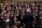 Baritone Stephen Powell, conducted by Music Director Robert Spano, right, and the Atlanta Symphony Orchestra and Chorus performing Britten's War of Requiem at Carnegie Hall in New York, NY on April 30, 2014.