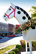 Tryon's town manager decorates Morris the horse with a Christmas wreath for the upcoming Holidays in Tryon, North Carolina.