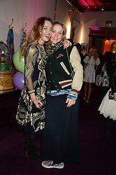 Left to right, ALICE TEMPERLEY and BAY GARNETT at the launch of Gordon's 'Ten Green Bottles' by Temperley London held at Temperley London Flagship, 27 Bruton Street, London on 6th November 2013.