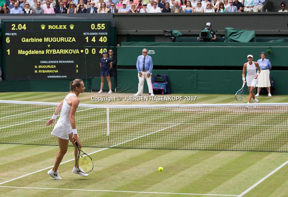 MAGDALENA RYBARIKOVA (SVK) und GARBI&Ntilde;E MUGURUZA (ESP),passing shot, <br /> <br /> Tennis - Wimbledon 2017 - Grand Slam ITF / ATP / WTA -  AELTC - London -  - Great Britain  - 13 July 2017.