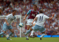 Photo: Tony Oudot. <br /> West Ham United v Manchester City. Barclays Premiership. 11/08/2007. <br /> Matthew Upson of West Ham clears his lines from Elano Blumer of Manchester City
