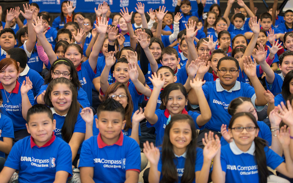 Students pose for a photograph during a financial education and success program sponsored by NBA Cares and BBVA Compass at Crespo Elementary School, February 27, 2014.