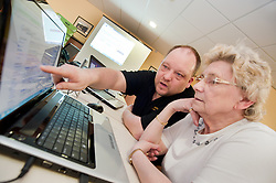 Digital Region Co-Running a series of workshops to equip the elderly with basic computer skills at Bakersfield Court sheltered housing on Longfellow Drive Rotherham - Greta Robbins with Jon Mayo Director of JMLB Genisis..21 March 2011.Images &copy; Paul David Drabble Digital Region Co-Running a series of workshops to equip the elderly with basic computer skills at Bakersfield Court sheltered housing on Longfellow Drive Rotherham<br />