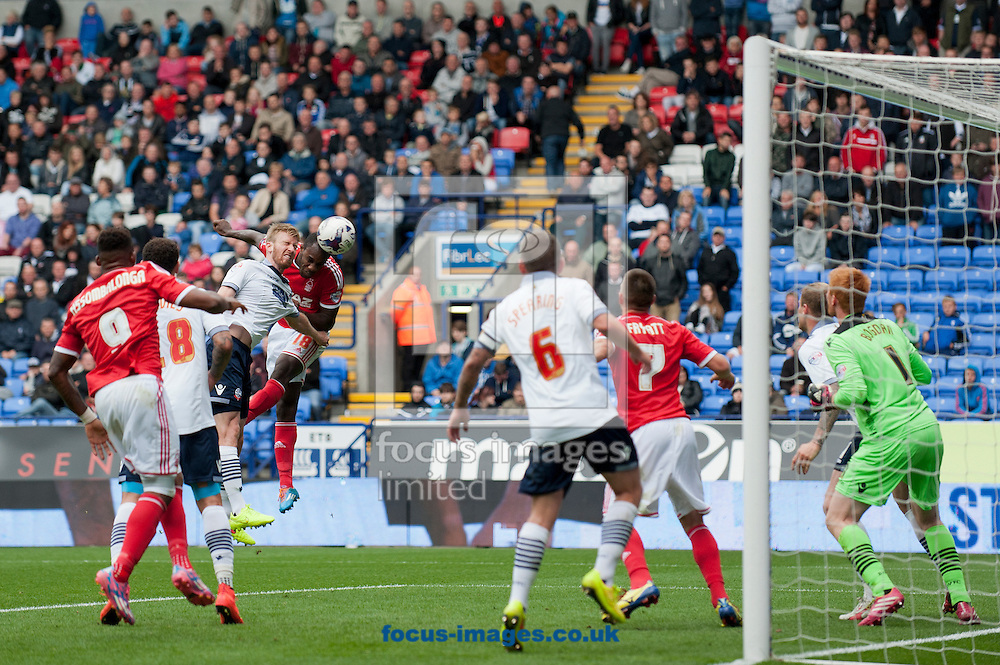 Michail Antonio of Nottingham Forest heads goalwards during the Sky Bet Championship match at the Macron Stadium, Bolton<br /> Picture by Russell Hart/Focus Images Ltd 07791 688 420<br /> 16/08/2014